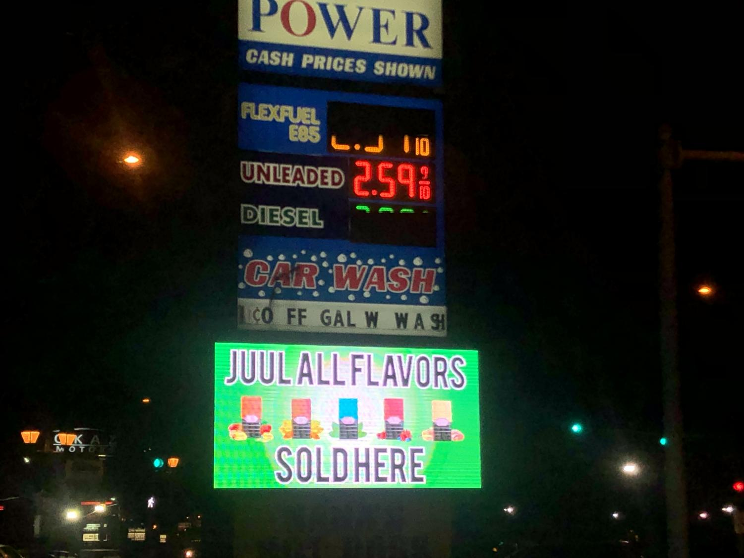 Power Mart, a local gas station showcases an ad for Juul Flavors.