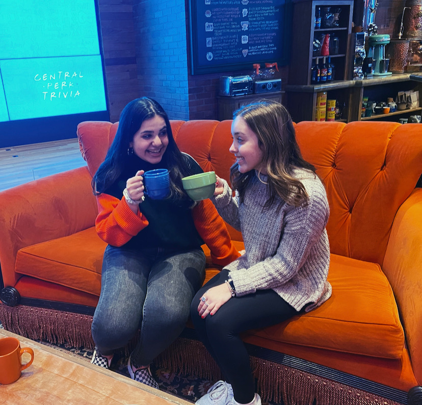 Sophomores Vanessa Bardhoshi and Tala Eisouh cheers to a great time at Central Perk in the Friends Chicago pop-up.