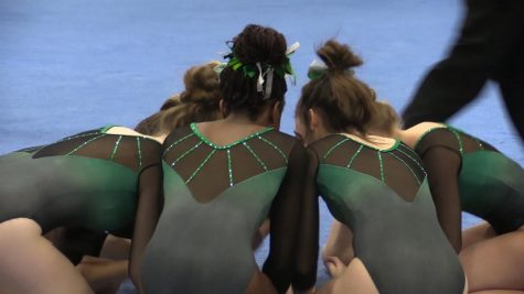 Gymnasts prepare for annual York Invite with their ritual chant.