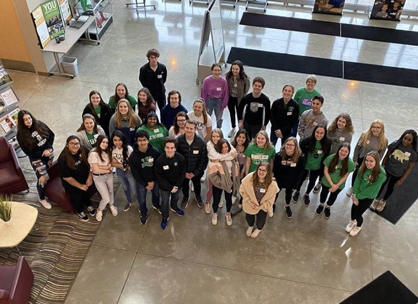 AP Spanish students at Northern Illinois Food Bank getting ready to begin their volunteering.