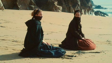 "The protagonists of ""Portrait of a Lady on Fire"" cover their face from the wind on the beach. The 2019 film was praised for being told through the ""female gaze"": female director, female cinematographer, female screenwriter, mostly all female cast."