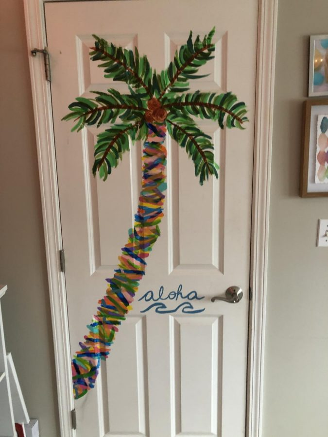 Senior Sydney Krueger's painting of a palm tree on her bedroom door portrays bright colors and a blue wave with