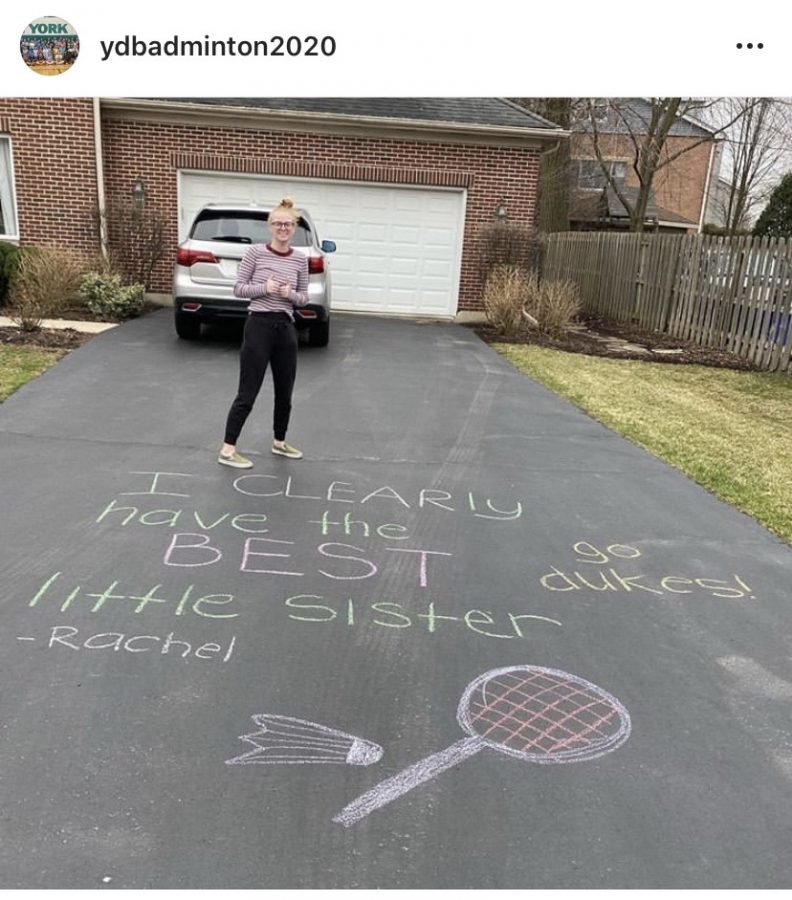 Senior Rachel Kayman supports her little while social distancing by leaving her a chalk message. Her message was posted on @ydbadminton2020.