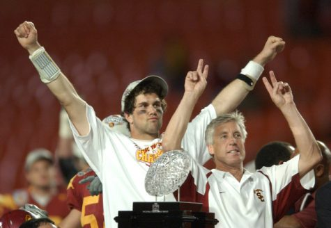 Matt Leinart celebrates with head coach Pete Carroll after winning the 2005 Orange Bowl against Oklahoma.