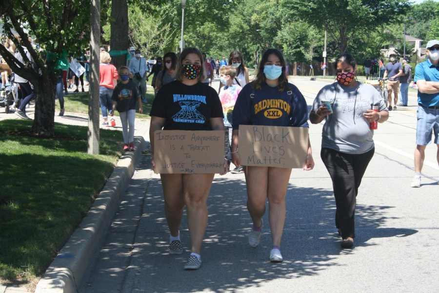 Two Elmhurst teens make their way to the corner of York Road and St. Charles Road in the Elmhurst March for Equality. June 13, 2020