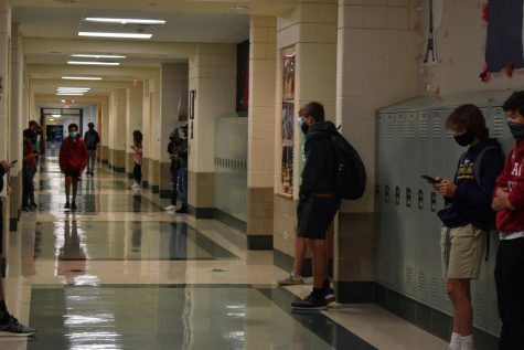 York sophomores join the freshmen for hybrid learning. In the the World Language hallway, students waited to enter their classrooms before school began. Sept. 28, 2020.