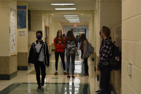 York sophomores join the freshmen for hybrid learning. On the third floor, students talked outside their classrooms prior to the first bell. All students were required to wear masks throughout the school day. Sept. 28, 2020.