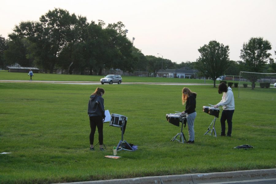 Freshmen attend their first day of school at York amid a historic 2020-21 school year. Drumline students rehearse in the soccer field during the fourth period block, greeting freshman as they arrive on their first day.