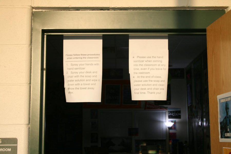 Freshmen attend their first day of school at York amid a historic 2020-21 school year. One Social Studies teacher outlined their COVID-19 safety expectations on paper hanging from the doorway.