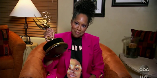 "Actress Regina King poses with her award for her role on ""Watchmen"" after giving an acceptance speech."