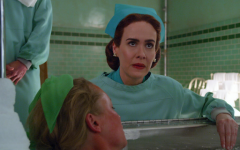 Still of Sarah Paulson, who plays Nurse Mildred Ratched, as she tends to one of her patient's diagnosis.