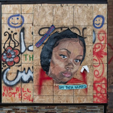 """A mural of Breonna Taylor at a memorial in Minneapolis. """"Say their names"""" became a rallying cry for activists, referencing the many victims of police brutality."""