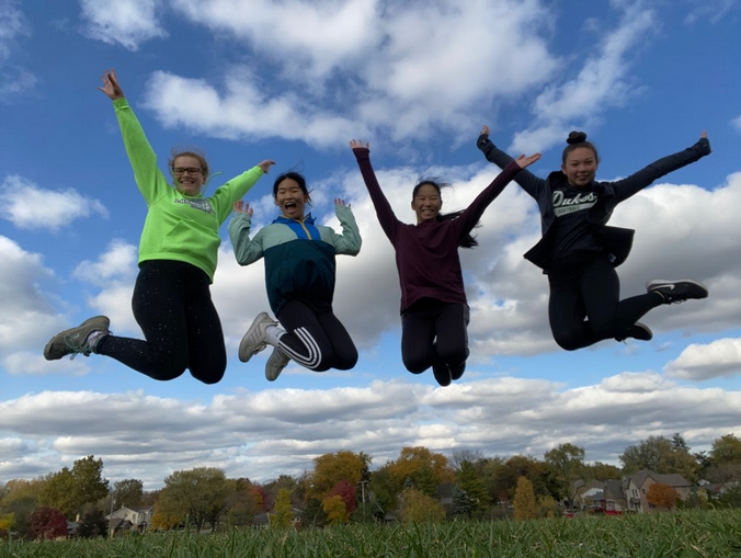 (Pictured from left to right) Juniors Rihanna Roberts, Madeline Fine, Claire Fine, and Emily Fujiwara jumping for their Fun Run submission.
