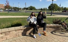 Senior Gianna Konieczny and junior and Co-President Lily Rende enjoy the temperate day for an outdoor meeting while wearing their Italian Club masks.