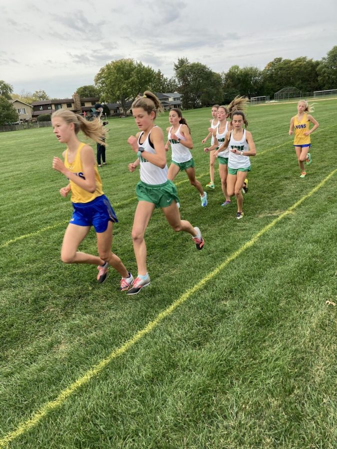 """Girls Cross Country varsity runners at the Lyons Township Highschool dual-meet on Saturday. Pictured is sophomore and top runner Brooke Berger followed by freshman Michaela Quinn, sophomore Bria Bennis, junior Kateyln Winton and freshman Katherine Klimek. """"We PR'd (got a new personal record) by so much!"""" Winton said."""