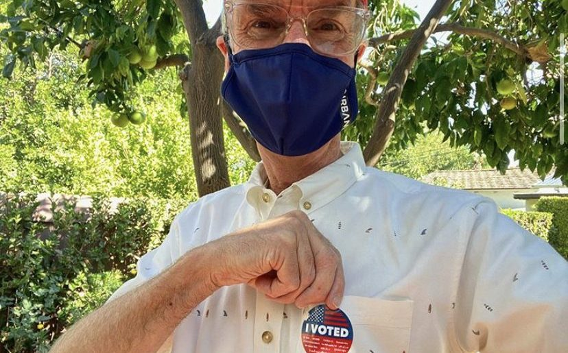 "Bill Nye poses in a mask with his ""I voted"" sticker in an Instagram post. Nye, who has been active in the climate change awareness movement captioned his photo, ""It's a beautiful day to get out and vote. #voteforscience."""