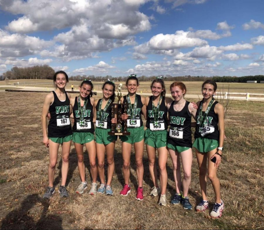 """Girls Varsity Cross Country top seven runners, juniors Katelyn Winton and Erin Powers, sophomores Bria Bennis and Brooke Berger, and freshmen Michaela Quinn, Maggie Owens and Katherine Klimek hold their state trophy after an undefeated 2020 season. """"Our whole top 7 is all coming back for next year and this is very motivating! We are all excited for next year hoping that things will go back to normal so that we could possibly get another state title!,"""" sophomore top runner Brooke Berger said."""