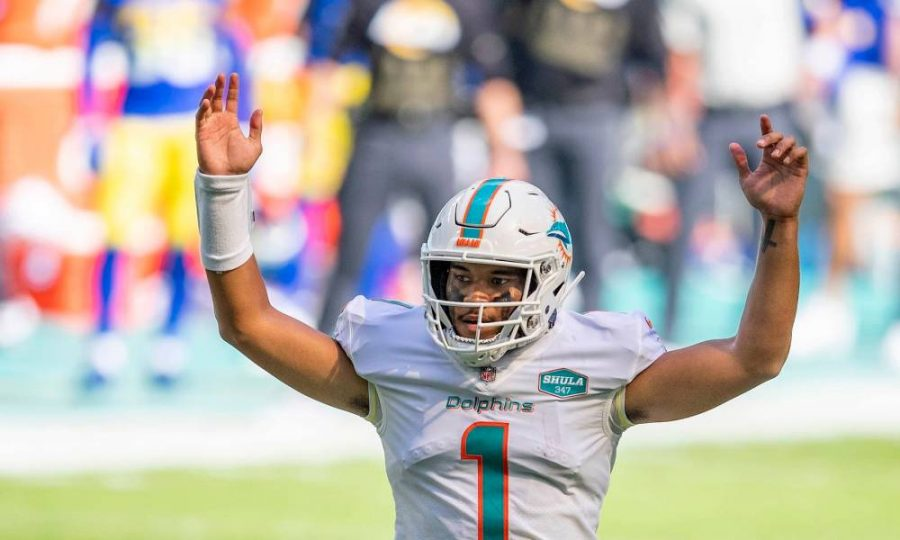Miami Dolphins rookie quarterback celebrating a win over the Los Angeles Rams in his first career start.