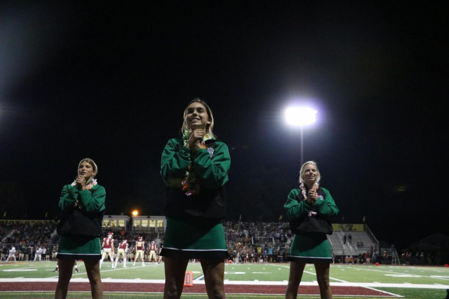 """Haley Brown smiled on the sidelines of the first football game against Schaumburg during the 2019-2020 season on August 30, 2019. Now, as a senior varsity cheerleader, Brown reflected on her time as a member of the cheer program as her season remains suspended. """"I found some of my closest friends through York cheer,"""" Brown said. """"I'll always cherish all of the memories we have together."""""""