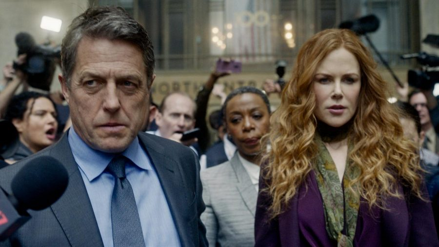 Still of Jonathan (Hugh Grant), Grace (Nicole Kidman), and Haley (Noma Dumezweni) being hounded by the press outside the courtroom on