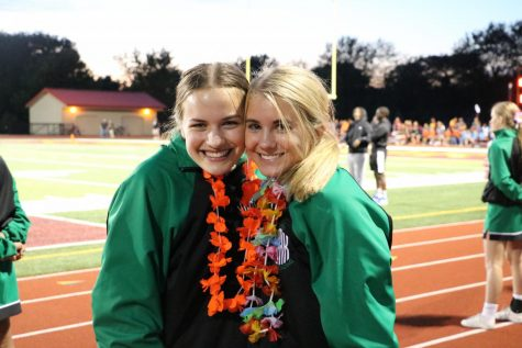 """As a junior, Grace Maniola took the role of a captain alongside graduate Emilie Sadowicz. The two cheered at the first game of the 2019-2020 season at Schaumburg in their leis for the Hawaiian themed football game. """"Even when Grace wasn't captain, she still found ways to show leadership in practice and competitions,"""" junior Bree Spallone said."""