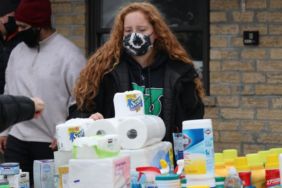 Junior Olivia Holubowicz assisted residents with the home and cleaning supplies. Residents were limited to one detergent along with several other limited products; however, other products were plentiful enough to allow for multiples.