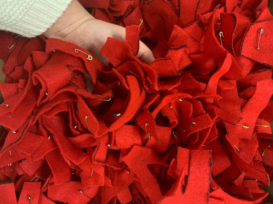 Each year, EMPOWER hands out red hearts to students as they enter through the academic doors.