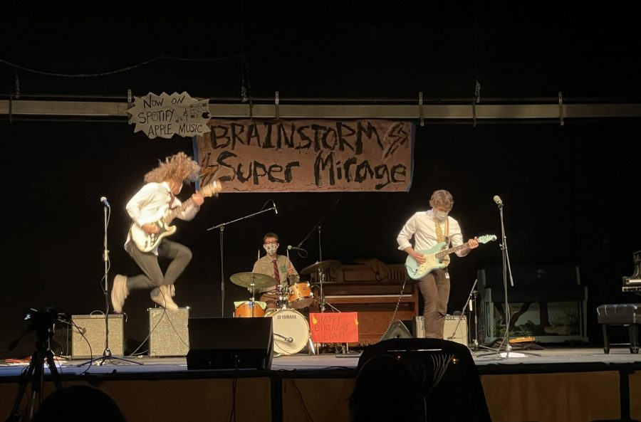 """Members of the bands Yolkdrop and Brainstorm performed on the auditorium stage on Friday during sixth period, which was streamed on YouTube Live. Their performance marks the first of this year's """"Fine Arts Month"""", a celebration of the arts to last the duration of March. Many of the members of both bands are York alums."""