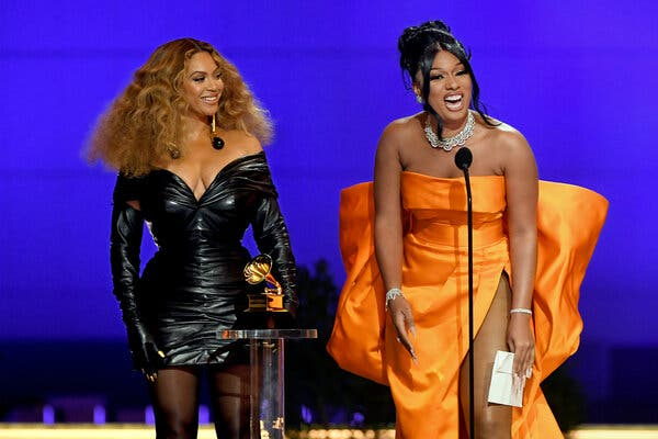 Beyoncé is pictured next to Megan Thee Stallion, who won three Grammy's last night, including Best Rap Performance for her hit