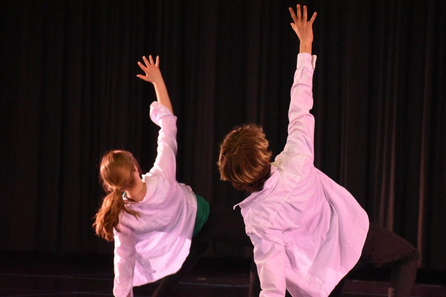 Senior Heidi Ward dances alongside junior Owen Espinosa in the Advanced Dance and York Dance Company Fine Arts Month concert. March 22, 2021.