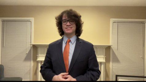 Photo of James Golen delivering his final round speech, recording himself to be viewed in a later ceremony. Golen received this ceremony after being crowned State Champion in both extemporaneous and impromptu speaking at the IHSA Speech State Series.