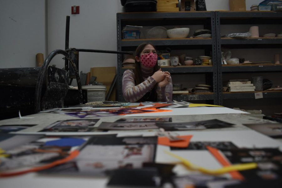 """York Senior April Fatheree, member of the Elmhurst Art Museum's Teen Art Council, works on a collage piece to be displayed in the museum's upcoming exhibition """"In Focus: The Chicago Freedom Movement and the Fight for Fair Housing"""". The exhibition opens March 4 and will feature artwork created by both Teen Art Council and Black Student Union + Allies members."""
