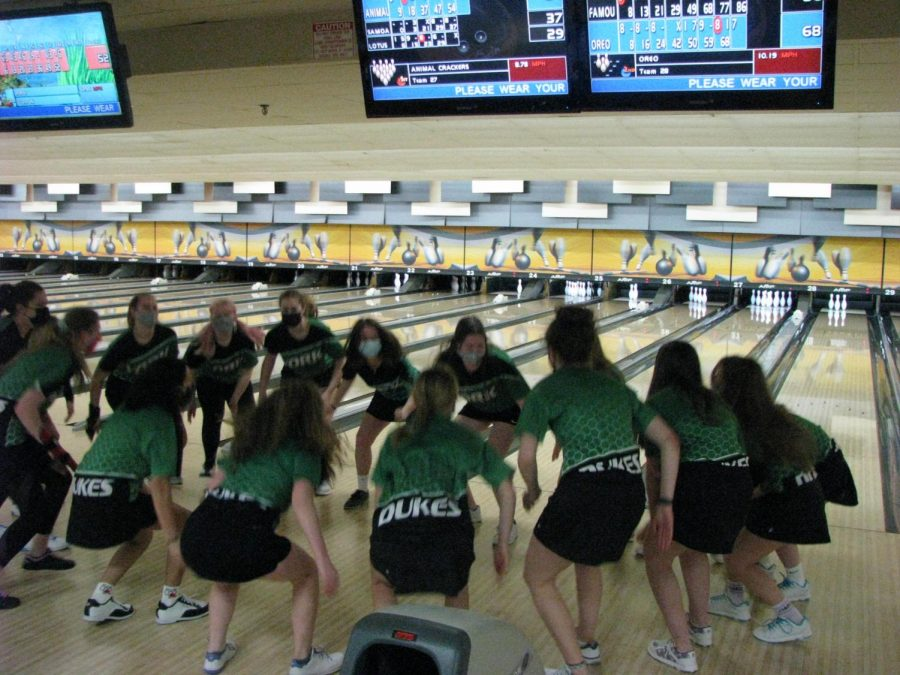 Here come the Dukes: At a junior varsity bowling practice on Friday, March 5, the team huddles up together to shout, clap and stomp their team chant at Stardust Bowling Alley.