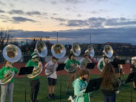 """A group of students in the Marching Band playing sousaphone line up to perform at a home football game.  """"Leading up to the first game, nothing really felt real-especially because of COVID-19 it"""