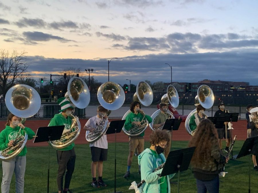 "A group of students in the Marching Band playing sousaphone line up to perform at a home football game.  ""Leading up to the first game, nothing really felt real-especially because of COVID-19 it's been hard to really look forward to something and expect it to happen,"" senior Rose Menichini said. ""When we came back, it all finally set in and it was so much fun to walk out on the field again and hear the pep band songs."""