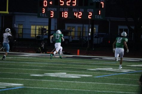 """Senior Sami Ayash runs to bring the Dukes to a tie game Friday night against Willowbrook. After a long and aggressive game the Dukes went on to win 25-23 to beat the unbeaten Willowbrook varsity football team. """"The whole year we"""