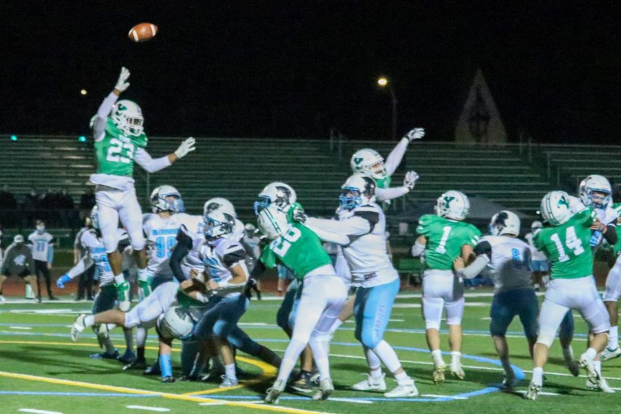 Senior Jeffery Grace III jumps up in an attempt to disrupt a field goal by Willowbrook. The game was back and forth the entire nightbut ended with an exciting 25-23 victory for the Dukes on their senior night.