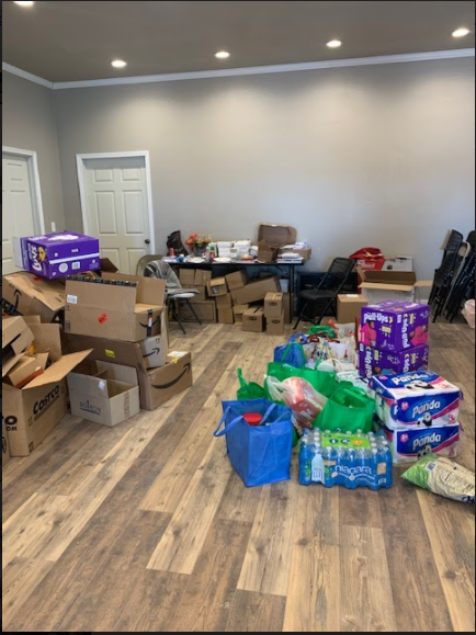 Empower club collects all the donations from their pine ridge toiletry drive, and thank those who donated.