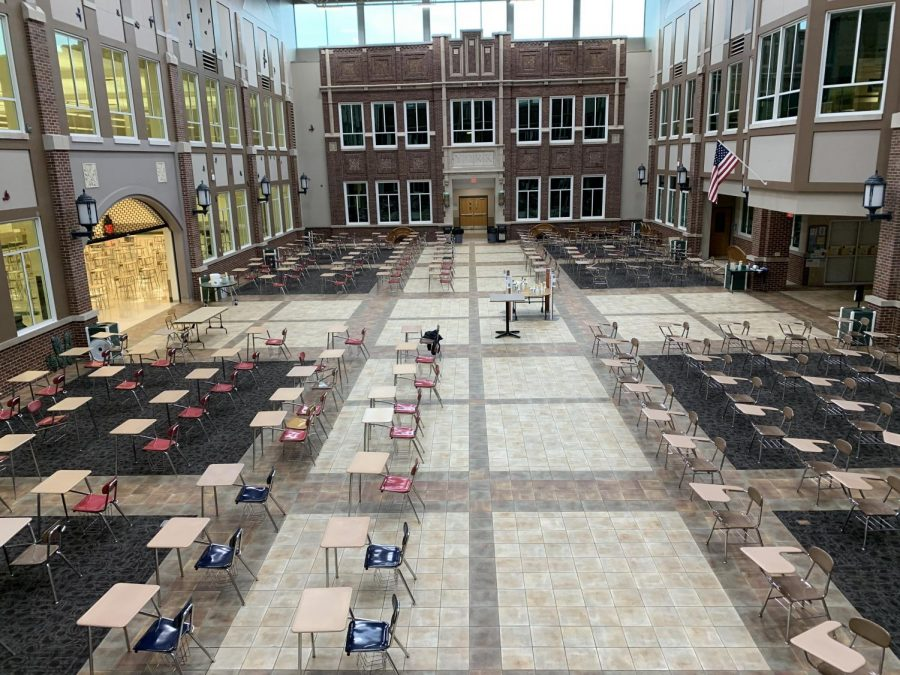 On April 12, all in-person students returned to a full eight-period schedule for the rest of the year. Students eat at separate desks during lunch to maintain distancing. Chairs were spread throughout the lunchroom, Commons and Joe Newton Field House.