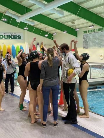 """The team finishes the game with a team cheer following their victory, a change due to COVID-19 protocols. """"We aren't allowed to shake hands after matches, so the sportsmanship is a little bit different,"""" senior Emma Stec said. """"We just do a cheer."""""""