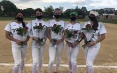 Seniors Emma Chael, Isabella Prosser, Lauren Derkowski, Molly Loch and Rena Sotos holding their flowers after senior night last Monday.