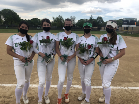 """Seniors Emma Chael, Isabella Prosser, Lauren Derkowski, Molly Loch and Rena Sotos holding their flowers after senior night last Monday. """"This season in particular, I am extremely proud of our captains and the leadership that they have shown since day one,"""" assistant coach Lisa Scola said. """"We have a special group of girls this year, and they work very well together."""""""
