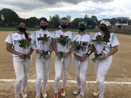 Seniors Emma Chael, Isabella Prosser, Lauren Derkowski, Molly Loch and Rena Sotos holding their flowers after senior night last Monday. This season in particular, I am extremely proud of our captains and the leadership that they have shown since day one, assistant coach Lisa Scola said. We have a special group of girls this year, and they work very well together.