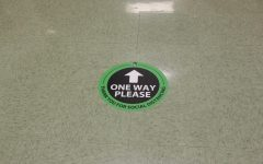 A one way sticker rests on the floor outside the atrium staircase on the 3rd floor of the academic wing. . Friday, July 2, 2021.
