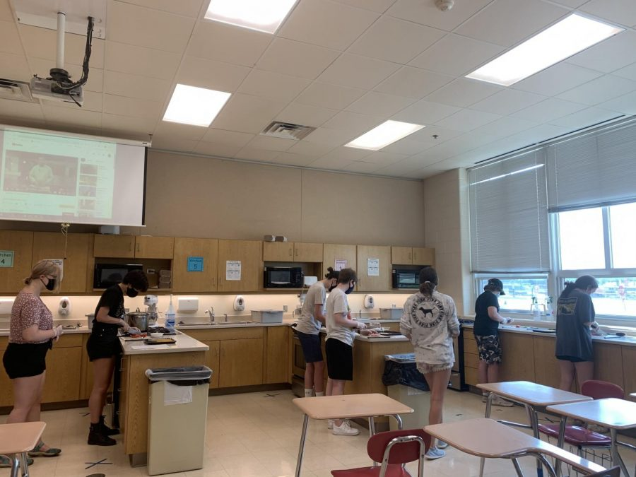 Chef's Corner students prep food for the day's project. Freshman begin their high shool experience early by attending summer school alongside other grades. July 2, 2021.