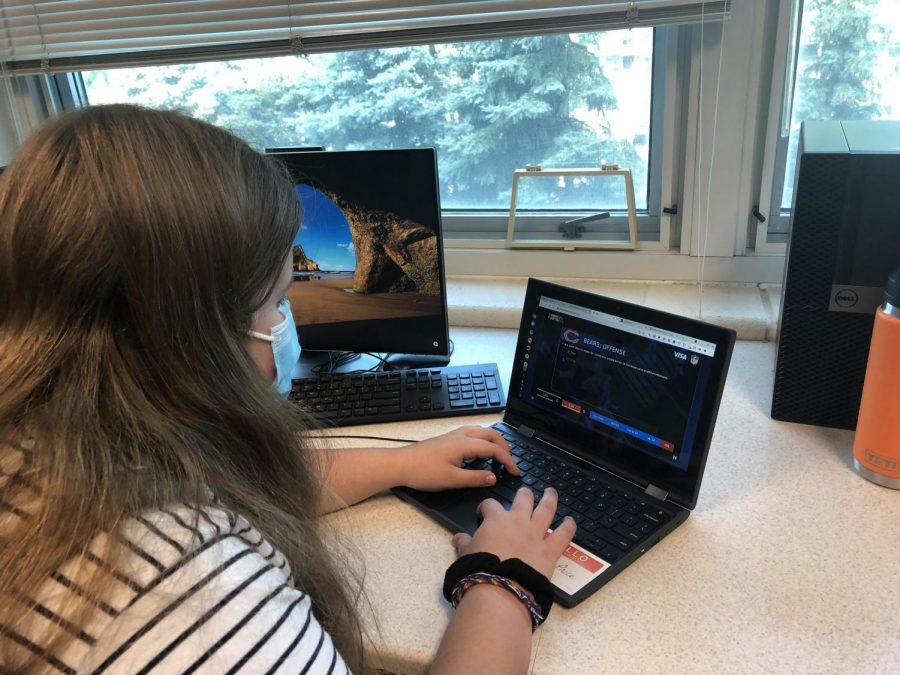 Sophmore Hannah Morey plays an interactive business game, which is part of the business curriculum. July 2, 2021.