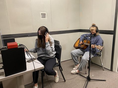 Alyssa Poli (left) and Quinn Olson (right) recording songs for their upcoming EP during Music Production 1 this summer. Poli is recording Olson's guitar for their new track. lyssa Poli (left) and Quinn Olson (right) recording songs for their upcoming EP during Music Production 1 this summer. Poli is recording Olson's guitar for their new track. June 29, 2021.