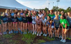 The girls cross country camp gathered before their morning practice in a tent located in Berens Park, where they prepared to complete their run. July 1, 2021.