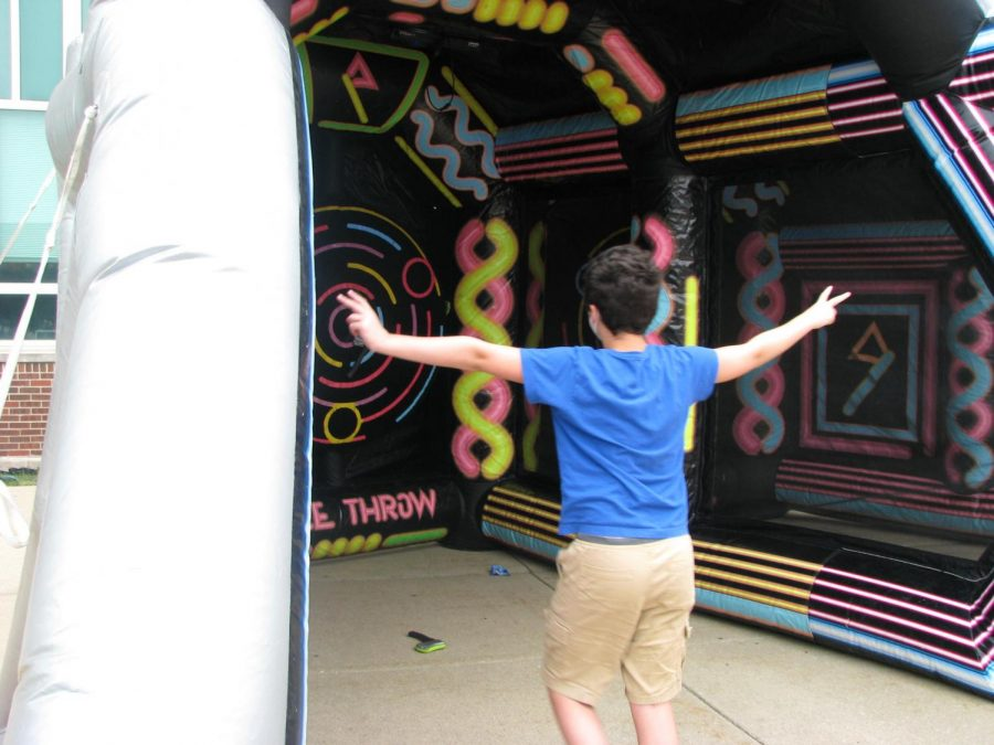 Bullseye%3A+Hallway+tours%2C+food+and+inflatable+neon+games+attract+students+and+parents+to+the+first+event+of+the+school+year.+The+York+Community+takes+advantage+of+the+sunshine+and+inflatable+axe+throwing+at+the+Back+To+School+Bash+on+Thursday%2C+August+12.
