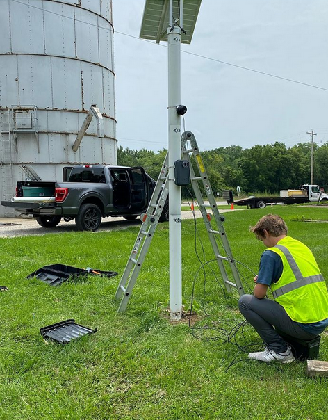 Kroy Railway Group Co-Founder Connor Polomsky installs a solar powered unit in the county of McLean. Photo provided by @kroyrailwaygroup on Instagram.